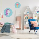 Blue armchair next to bed with blanket in colorful child's bedroom interior with posters