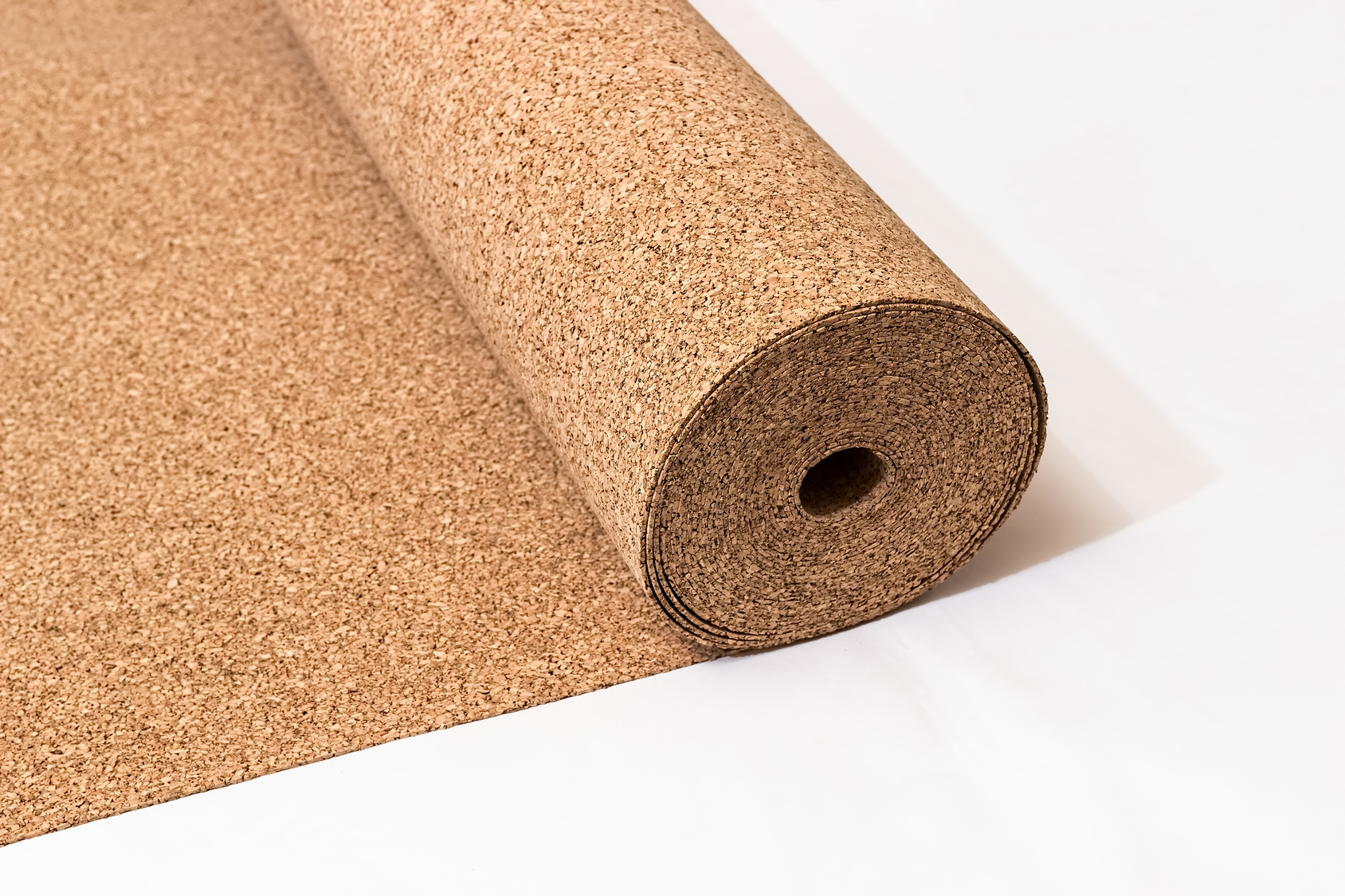 Roll of wood cork on a white background.
