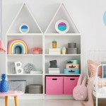 Sweet colorful decorations and white furniture in a fun kid's bedroom interior with a pastel pink rabbit pillow toy